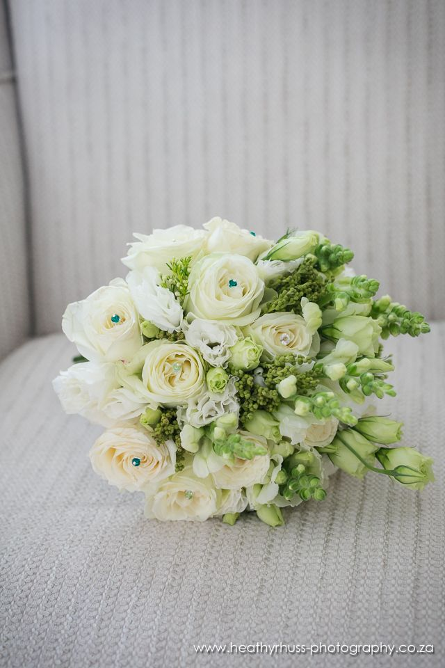 Bouquets of White Avalanche rose, lisianthus, and snapdragon . Thanks to Heathyr Huss Photography