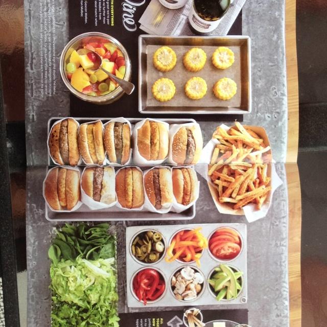 Burger bar with interesting toppings in Mason jars