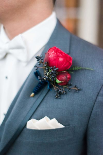 Rich red boutonniere: http://www.stylemepretty.com/texas-weddings/houston/2015/04/27/winter-glam-wedding-with-navy-sequins/ | Photography: Dana Fernandez - http://www.danafernandezphotography.com/