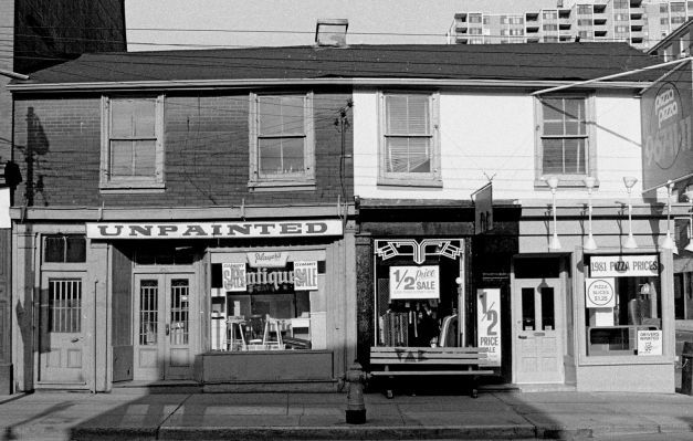 A Timeline of Storefronts  Written by Shawn Micallef (co-owner of Canadian urbanism magazine Spacing), Full Frontal T.O. features Cummins's extensive photography collection, telling the story of Toronto's dramatic transformation through its changing buildings.  272-274 Queen Street West, 1983