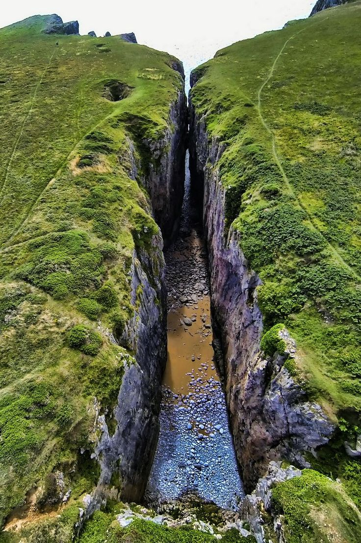 Huntsman's Leap, a narrow steep sided inlet formed by sea erosion along a fault…
