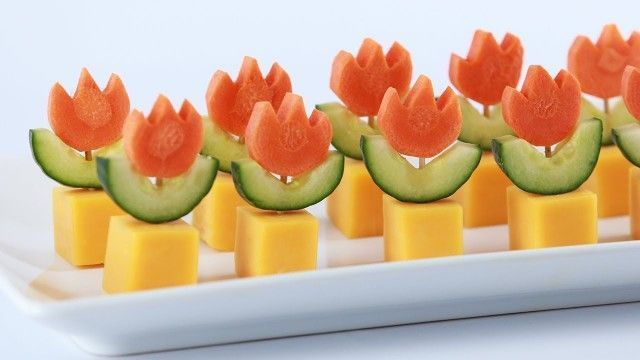 ?  CUT CUCUMBER INTO WHEELS AND THEN IN HALF.  CUT CARROT INTO WHEELS TOO, AND MAKE 3 PETALS ON TOP OF EACH WITH A SMALL KNIFE.   CUT CHEESE INTO CUBES.  TAKE ONE BY ONE TOOTHPICK AND STICK THEM IN, CHEESE FIRST.  FOLLOW LINK FOR OTHER INSPIRATIONS   #FUN (fruit snacks for kids)