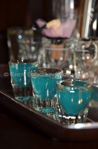 """Blue Balls Shots 1 measure Blue Curacao 1 measure Coconut Rum 1 measure Peach Schnapps 1 measure Lemon Juice Combine liquids in cocktail shaker with ice. Shake to blend and chill. Strain into multiple shot glasses. Serve with """"U and Ur Hand"""" by Pink playing loudly in the background."""