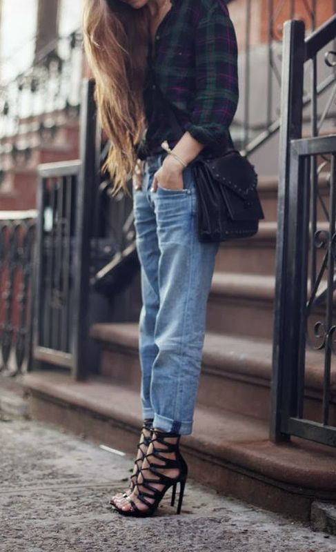 Gorgeous green pleated check shirt with blue casual stylish jeans and black leather hand bag and black stylish high heels ladies sandals the...