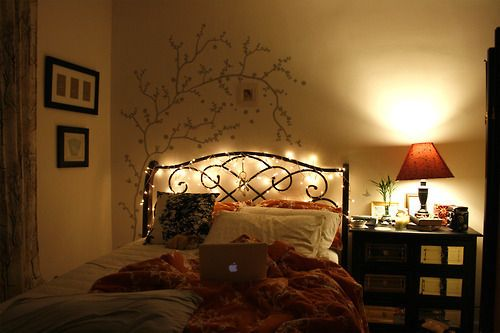 white lights behind headboard rather than bedside lamp... and the stenciled tree behind it!