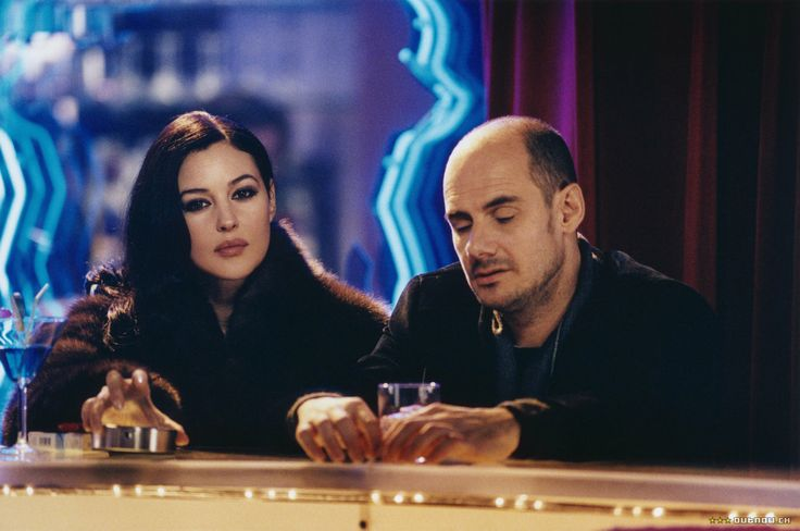 """Film still of Italian actress Monica Bellucci and French actor Bernard Campan in """"Combien tu m'aimes"""" - """"How Much Do You Love Me?"""" a 2005 French romantic comedy film written & directed by Bertrand Blier."""