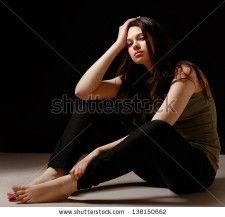 stock-photo-depressed-woman-sitting-on-floor-isolated-on-black-background-138150662
