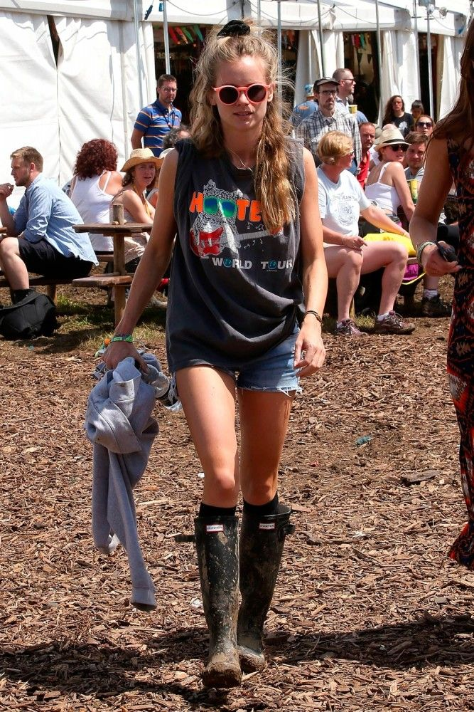 Cressida Bonas wearing Hunter Original at Glastonbury 2014 | Harper's Bazaar