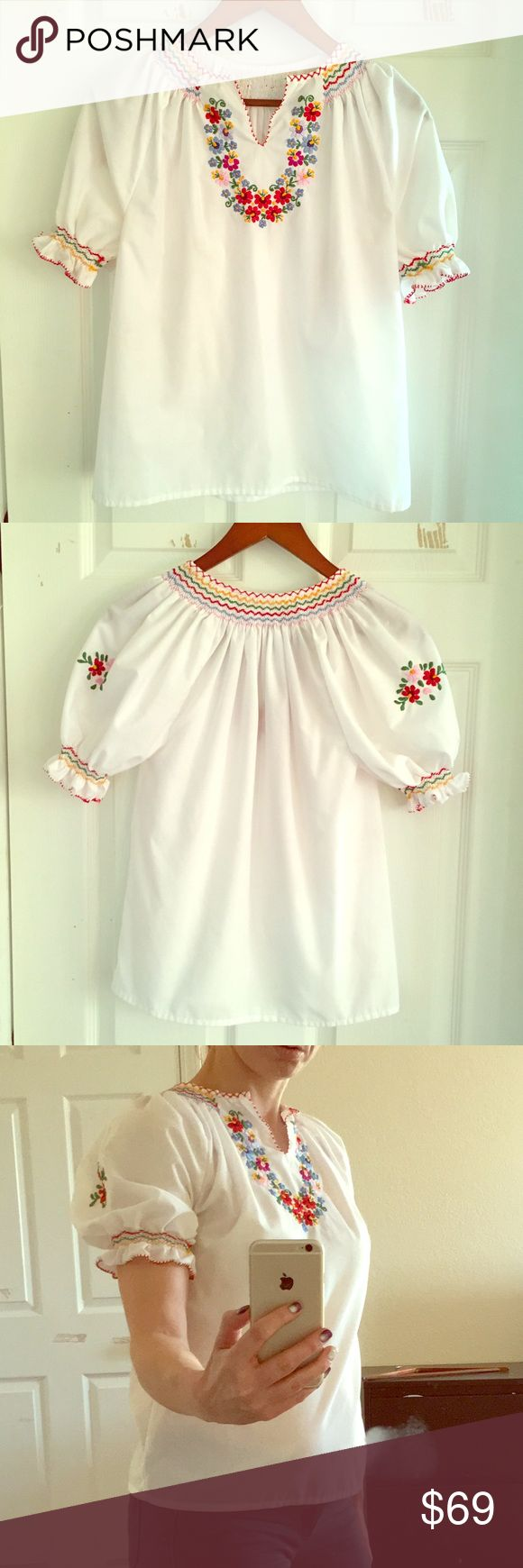 Hungarian hand-embroidered  folk wear shirt Authentic, traditional, hand-embroidered Hungarian folk wear shirt from Hungary. The lady's name who made it is printed inside. Lightly worn, like new, no signs of wear! Beautiful, one-of a kind piece. There's no indication of size but see how it fits on a size XS on the photo. It's definitely XS, not supposed to be snug. Tops Blouses