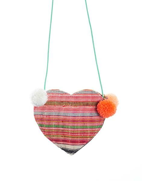 This Mini Heart Purse adds the perfect pop of color to any outfit! {The Little Market}