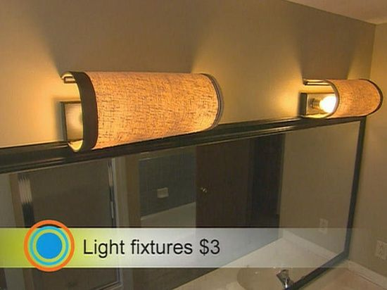 Best 25 bathroom light bar ideas on pinterest farmhouse lamp shade cut in half and mounted to cover ugly bathroom light bars mozeypictures Choice Image