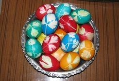 Cool egg dying trick with leaves, stockings, & dye. My Romanian students taught me to do this--only using onion skin for dye.