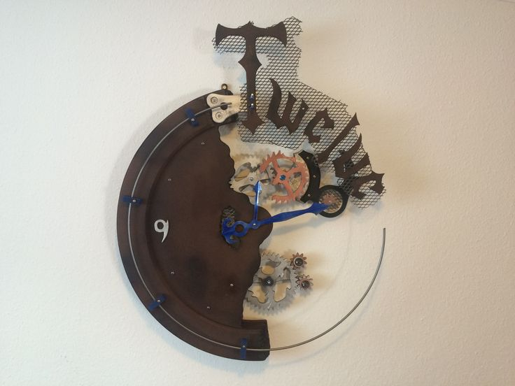 Handmade kinetic wall clock sculpture, crafted of MDF boards and metal. The quartz clock movement is German, high torque, requires 1 pc AA battery (included). The gear movement is separated from the clock movement, needs 220/230V.  Color: dark brown with silver and copper gears, with dark blue elements. Measures: 80 cm (31 in) wide, 100 cm (39 in) high, 13 cm (5 in) deep. The clock weighs 11 kg (24,44 lb).