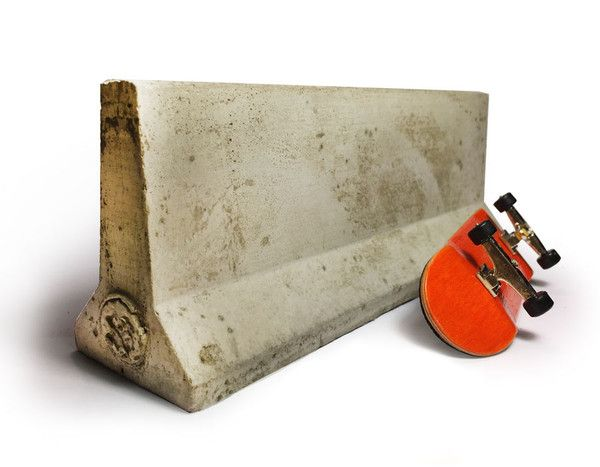 "A jersey barrier fit for a king! Made from real cement, this jersey barrier is 7"" long and heavy duty. Perfect for fingerboarders, also works well as a paperwei"