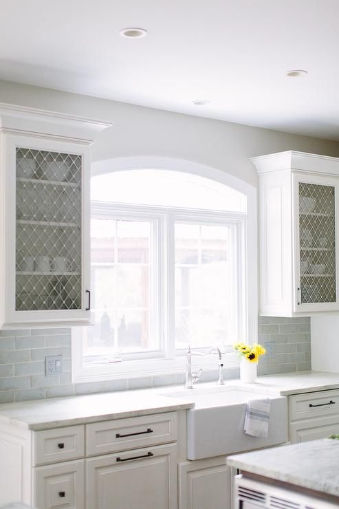 Lovely Kitchen Features White Raised Panel Cabinets Paired