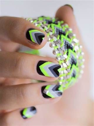 Nail art blogger, Pshiiit, had fun with neon and created this awesome pattern! Visit Beauty.com to get the nail colors you want to recreate this look.