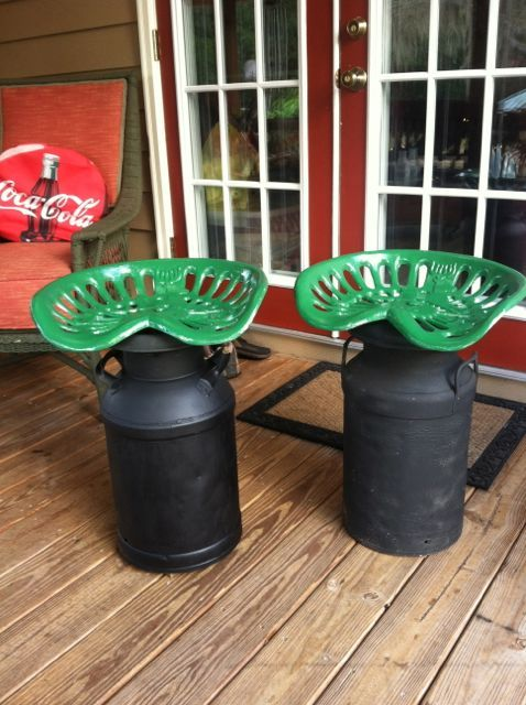 Porch stools we made from old tractor seats and milk cans. We attached wood underneath to keep them from leaving a rust stain on the wooden porch.