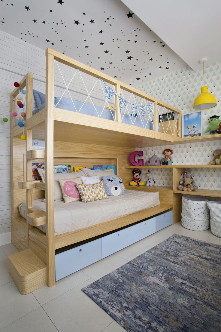 Bunk bed in children's room with stars wallpaper on the ceiling