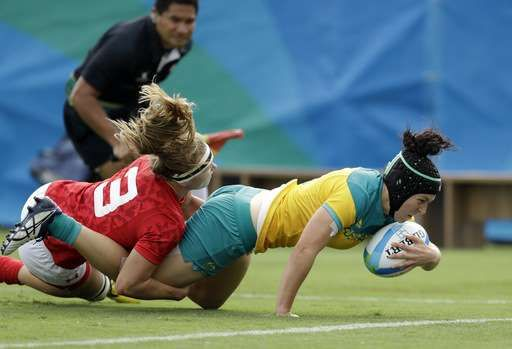 Australian women win 1st gold medal for Olympic rugby sevens  -  August 8, 2016  -     Australia's Emilee Cherry, right, scores a try as Canada's Karen Paquin, defends during the women's rugby sevens semi final match at the Summer Olympics in Rio de Janeiro, Brazil, Monday, Aug. 8, 2016. (AP Photo/Themba Hadebe)