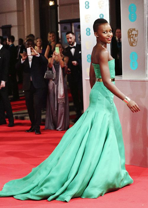 Lupita Nyong'o arrives on the red carpet for the EE British Academy Film Awards in London on February 16, 2014
