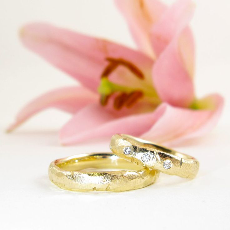 Cool and coarse wedding rings with diamonds- one of a kind  If regular shiny bling is boring you, these 14k gold rings are perfect. I have given the pair a hardcore treatment with my coarsest file and set 3 feminine 0,02 carat diamonds in her ring for some understated bling