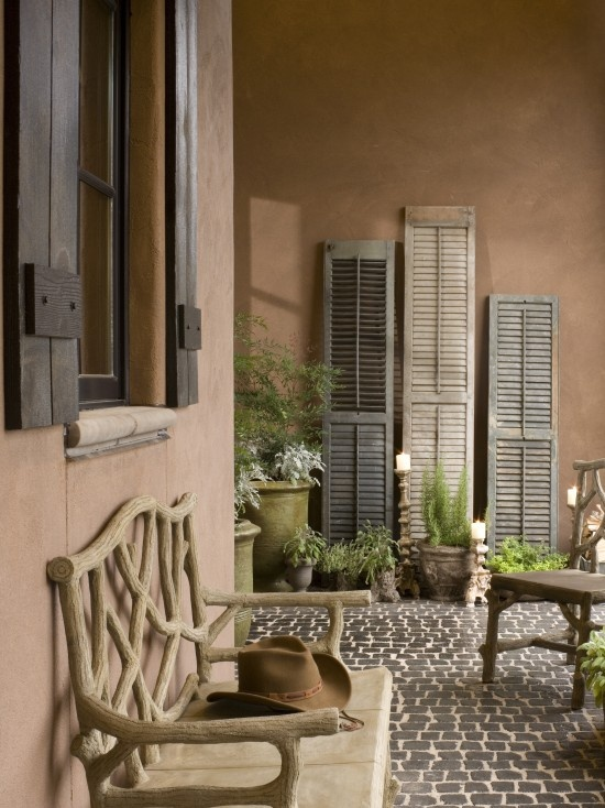 Love the weathered terracotta color home exteriors for Decorating with old windows and shutters