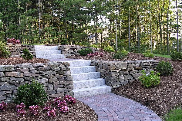 terraced retaining walls in the woods with steps