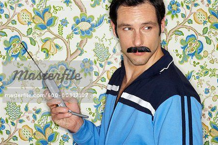 Stock photo of Portrait of Man With Retro Cell Phone   ; Premium Royalty-Free, 600-00917107 © Masterfile. All rights reserved.
