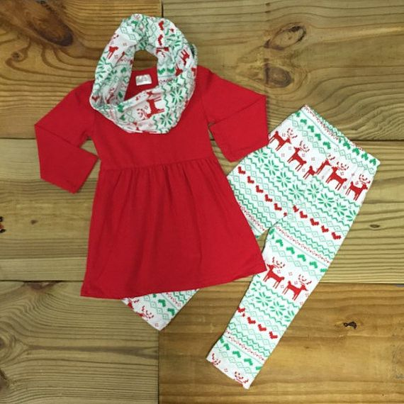 This girl's Christmas outfit is totally trendy and super comfy! With a solid red tunic top, aztec reindeer print leggings and matching infinity scarf, this outfit is perfect for those Christmas photos