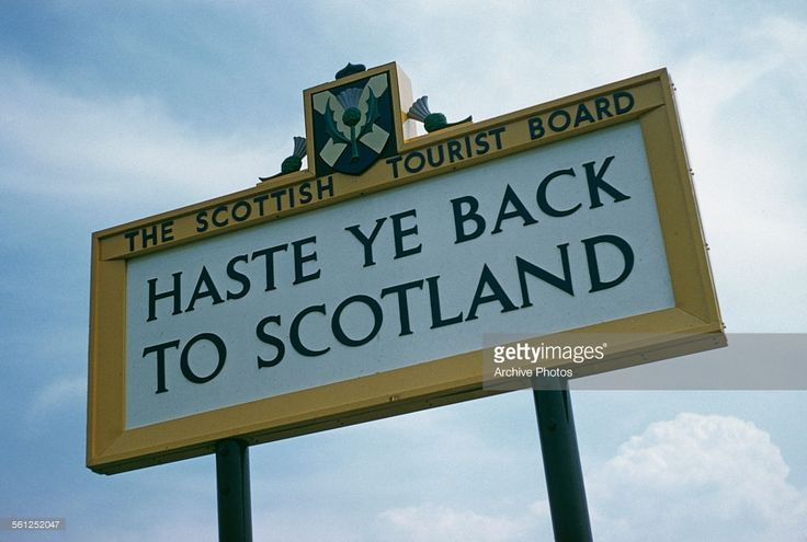 A sign from the Scottish Tourist Board reading 'Haste Ye Back To Scotland', Scotland, UK, 1959.