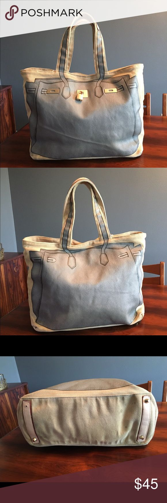 "V73 Canvas Tote Bag Grey designer style V 73 A fun canvas tote by V73. This bag has a picture of a Birkin bag on the front. Great for everyday, travel, or a beach bag. The bag looks pretty good when being carried but when examined it is quite used with spots on the bottom and wear discoloration to the corners, and one of the ""feet"" is missing. The interior is ok with a few pen marks and spots. 13"" tall 19"" wide 7"" deep. Sorry NO TRADES. V73 Bags Totes"