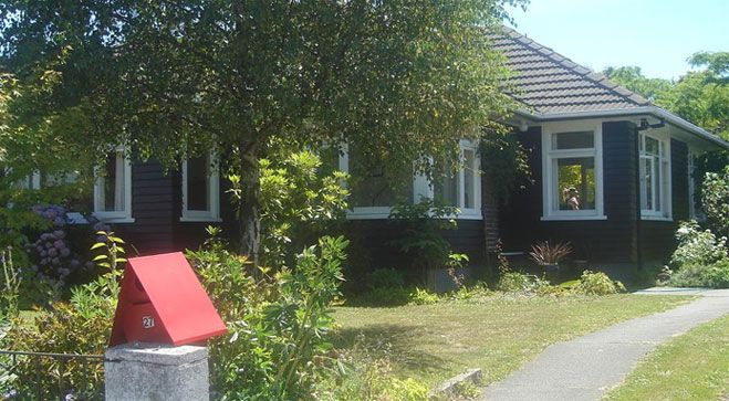 Dark weatherboards painted with Resene Sonyx CoolColour