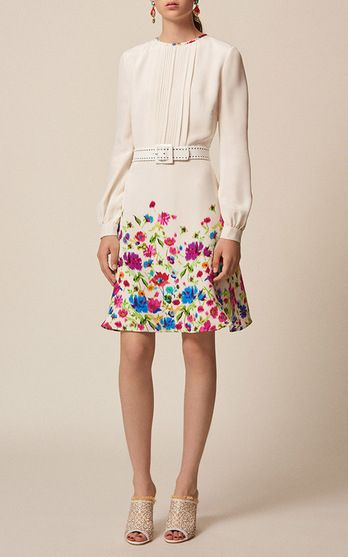 Formerly of Nina Ricci, designer Peter Copping has a love of interiors, fondness for color and years making girlish knits and slim-cut dresses feel sexy. This season, he channels the festive Resort spirit signature to the Oscar name via archival prints, a new skirt shape and floral embellishment. The pieces to buy? From Oscar, a dress is a must, and the fit-and-flare, '50s silhouette is among our favorites.