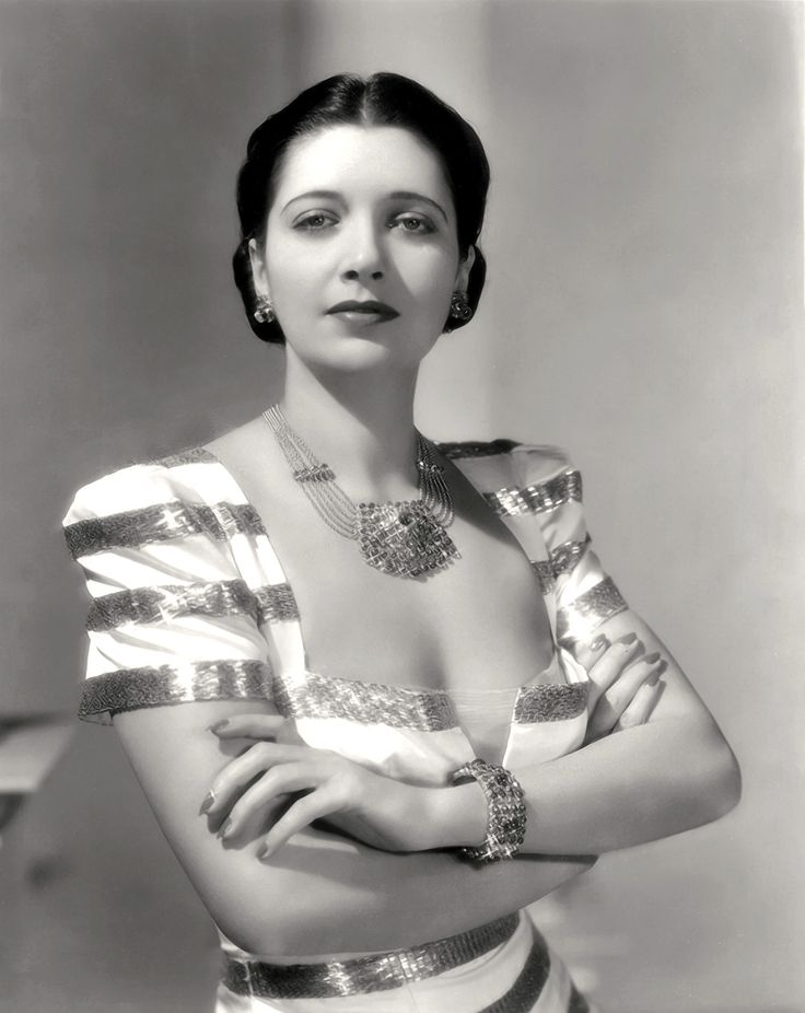 "KAY FRANCIS ~ Born: Jan 13, 1905 in Oklahoma City. Died: Aug 26, 1968 (aged 63) from cancer. After a brief period on Broadway in the late 1920s, she moved to film. Started w/ a bit part in ""The Cocoanuts"" (1929) w/ the Marx Brothers. Appeared in ""Trouble in Paradise"" (1932) followed by ""One Way Passage"" (1932). Had major hits w/ ""I Found Stella Parish"" & ""Confession"" (1937). Her final film was ""Shadow of Blackmail"" (1946) before retiring permanently in 1952."