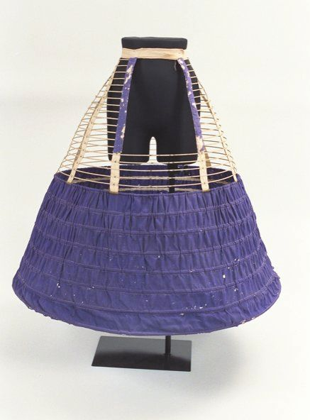 Ca.1860 cage crinoline with purple fabric lower section. Bunka Gakuen Costume Museum. (Note: don't bother to click through; link goes to some random page.) [jrb]