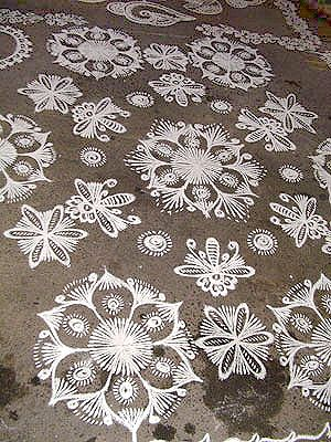 small rangoli patterns forming larger piece