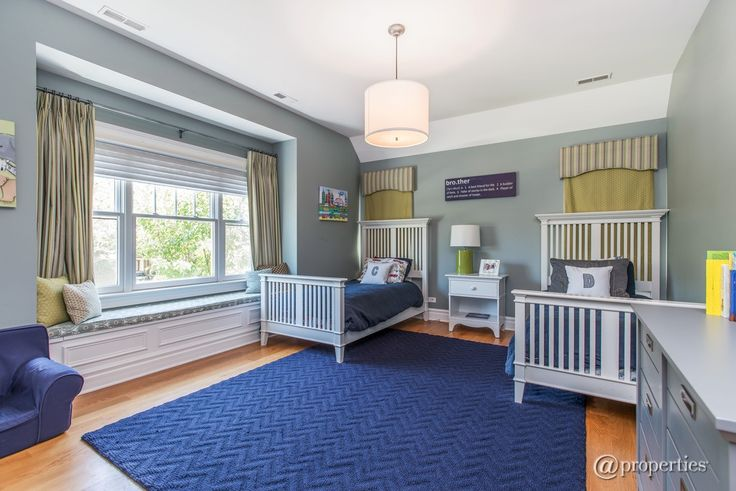 Transitional Kids Bedroom with High ceiling, flush light, Window seat, Hardwood floors, Carpet