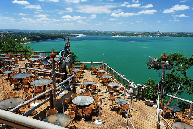 The Oasis on Lake Travis in Austin, Texas, USA. Located on a cliff 450 feet above Lake Travis, the largest outside seating in Texas boasts masterful views. Menu items include enchiladas, chile rellenos, fajitas, and seafood-stuffed avocados.