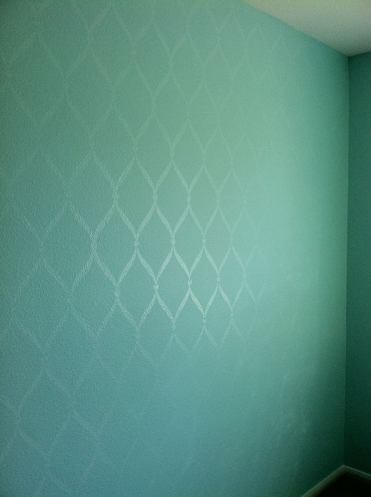 Paint the wall with flat paint. Use a stencil and use high