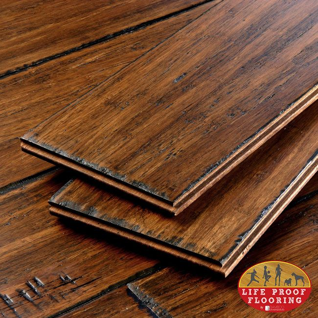 Invincible no scratch flooring! Love the distressed wide plank hand scraped look.. And it's bamboo but doesn't have the 'bamboo' pattern!