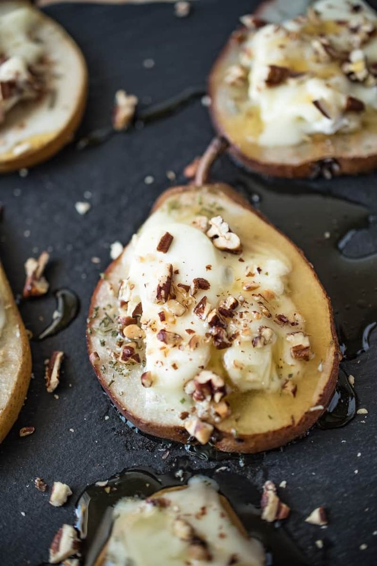 Baked pears with Chevrot goat cheese, honey & pecans is a very easy, healthy snack. Pears are sliced thin, baked then topped with tangy goat cheese, honey, pecans and fresh rosemary. Impressive enough to serve for dinner parties and perfectly fitting for the holiday season.