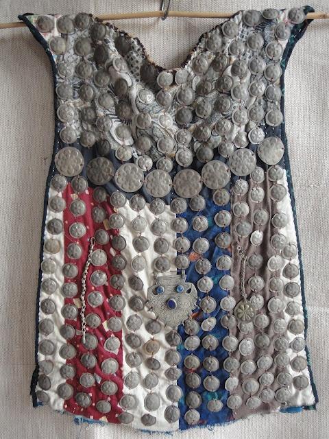 Metal caps adorned waistcoat, Central Asia
