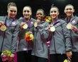 Team U.S.A members McKayla Maroney, Jordyn Wieber, Gabrielle Douglas, Alexandra Raisman, and Kyla Ross pose with their gold medals after the women
