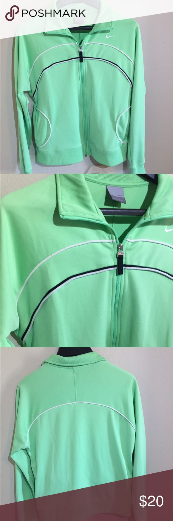 Nike Lime Green Zip Up Jacket Nike bright lime green jacket with black and white piping. It has a full zip front and pockets on both sides. There is elastic at the bottom, as well as on both cuffs. It is polyester, with the classic exercise jacket feel to it. Last picture shows a small stain on the right armpit. Great condition. Nike Jackets & Coats