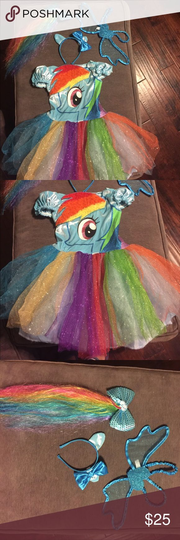 "Rainbow Dash costume sz 4-6x Full Rainbow Dash costume with headband ears/bow, wings, and rainbow ponytail barrette (that we clipped to the back of the dress as a ""real tail"" instead).  Excellent condition. No rips or stains. Smoke free home.  Update:  Found the fingerless gloves and another headband (broken)  that go with this set.  See additional photos My Little Pony Costumes"