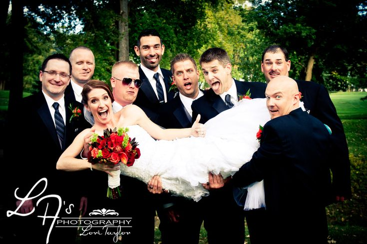 Bride with groomsmen, funny wedding photos