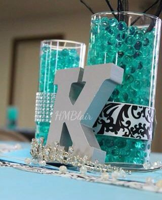 Black & turquoise Sweet Sixteen centerpiece with water beads. More