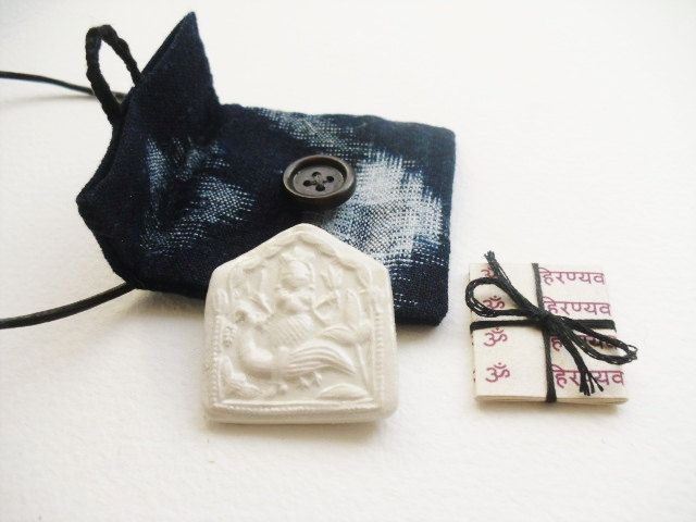 Handmade Lakshmi wealth pendant, Goddess amulet / talisman pouch, cream clay Goddess relief & sacred mantras in handmade indigo pouch by GaneshasRat on Etsy