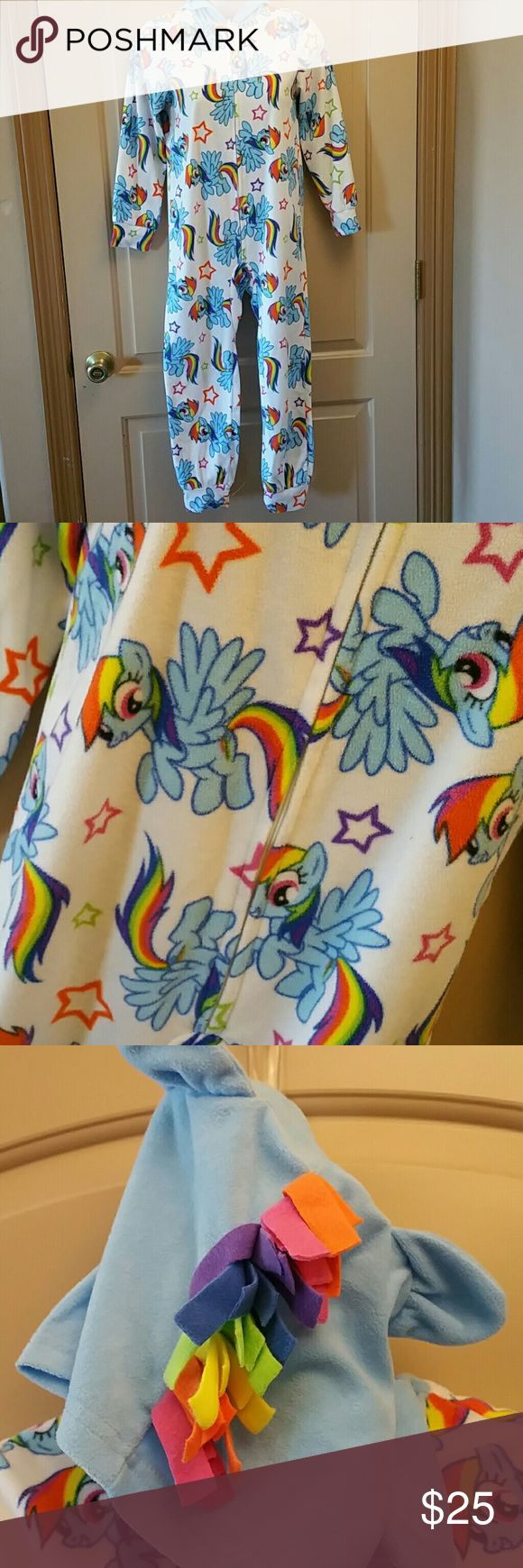 My Little Pony Rainbow Dash Pijama / Costume - Lg What girl wouldnt want to be Rainbow Dash anytime she pleases? This My Little Pony Rainbow Dash Pijama /costume is perfect just for that. It's a thick fleece material thus making it comfy and cozy for indoors yet durable for outdoors. It even has a Hoodia complete with a rainbow mohawk! Size Youth Large (8-14). My Little Pony Pajamas