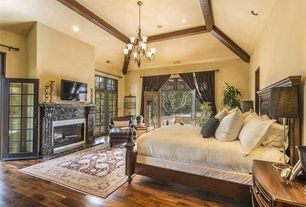 Mediterranean Master Bedroom with Antique Distressed Oak Flooring, RH Montpellier Panel Bed, High ceiling, Exposed beam